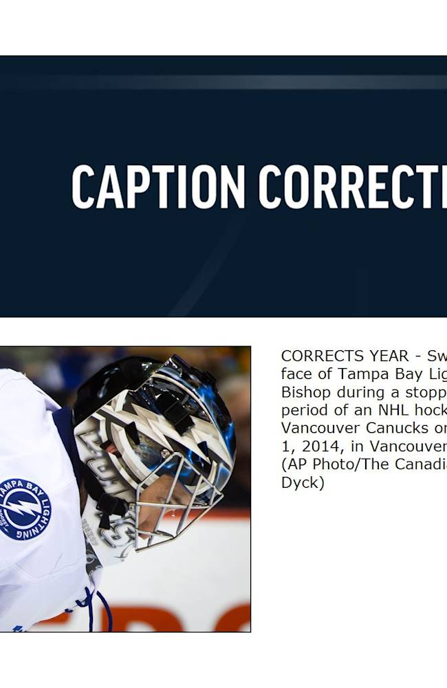 CORRECTS YEAR - Sweat drips from the face of Tampa Bay Lightning goalie Ben Bishop during a stoppage in the first period of an NHL hockey game against the Vancouver Canucks on Wednesday, Jan. 1, 2014, in Vancouver, British Columbia