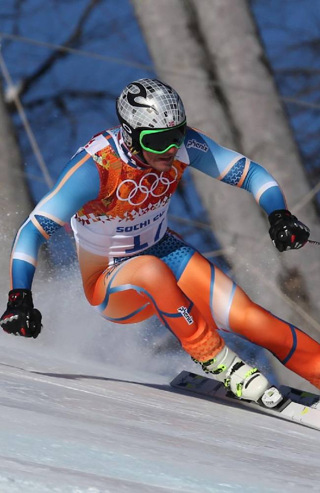 Norway's Aksel Lund Svindal makes a turn during men's downhill training at the Sochi 2014 Winter Olympics, Thursday, Feb. 6, 2014, in Krasnaya Polyana, Russia. (AP Photo/Luca Bruno)