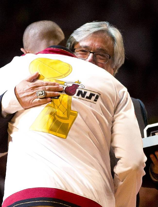 Miami Heat's Shane Battier gets his NBA championship ring from team owner Micky Arison before the Heat played the Chicago Bulls in a basketball game Tuesday, Oct. 29, 2013, in Miami