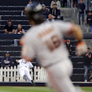 San Francisco Giants' Angel Pagan, foreground, heads to second as San Diego Padres center fielder dives for the ball but cannot make the play at the warning track in the first inning of a baseball game on Friday, April 18, 2014, in San Diego The Associate