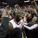 Maryland forward Charles Mitchell, center, celebrates with fans after defeating North Carolina State 51-50 in an NCAA college basketball game in College Park, Md., Wednesday, Jan. 16, 2013. (AP Photo/Patrick Semansky)