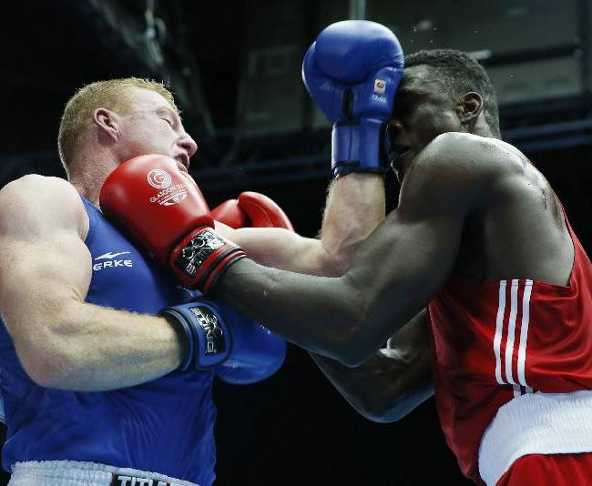 Efe Ajagba of Nigeria, right, exchanges punches with Paul Schafer of South Africa during their super-heavyweight boxing bout at the Commonwealth Games Glasgow 2014, in Glasgow, Scotland, Tuesday, July, 29, 2014