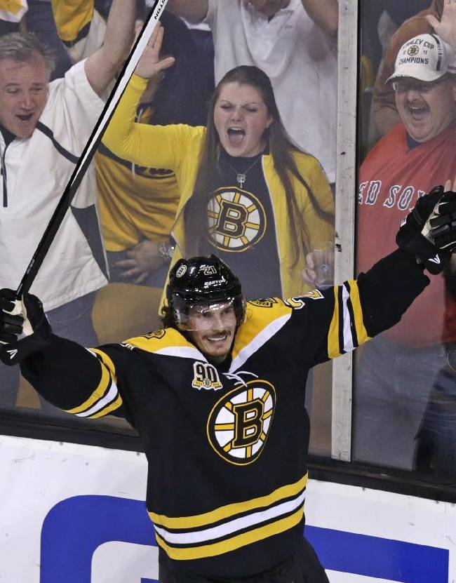 Boston Bruins left wing Loui Eriksson (21) celebrates his goal against Montreal Canadiens goalie Carey Price during the third period of Game 5 in the second-round of the Stanley Cup hockey playoff series in Boston, Saturday, May 10, 2014