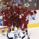 Arizona Coyotes' Sam Gagner (9) celebrates his goal scored against Los Angeles Kings' Peter Bartosak (65) with teammates Brandon Gormley (33), Shane Doan (19), and Oliver Ekman-Larsson (23) during the second period of a preseason NHL hockey game Monday, Sept. 22, 2014, in Glendale, Ariz. (AP Photo/Ross D. Franklin)