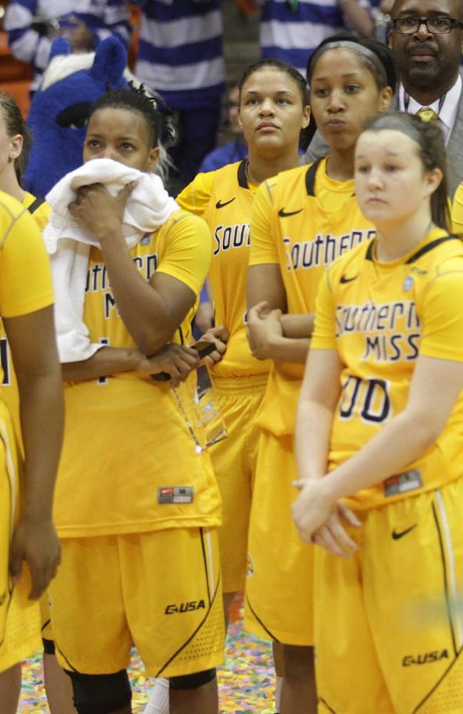 Southern Miss players watch Middle Tennessee receive their championship trophy following their NCAA Conference USA championship college basketball game Saturda, March 15, 2014 in El Paso, Texas