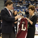 UConn president Susan Herbst, right, exchanges a team jersey brother, Jeffrey Herbst, Colgate's president before an NCAA college basketball game between the two schools in Hartford, Conn., Wednesday, Nov. 28, 2012. Connecticut won 101-41. (AP Photo/Jessica Hill)