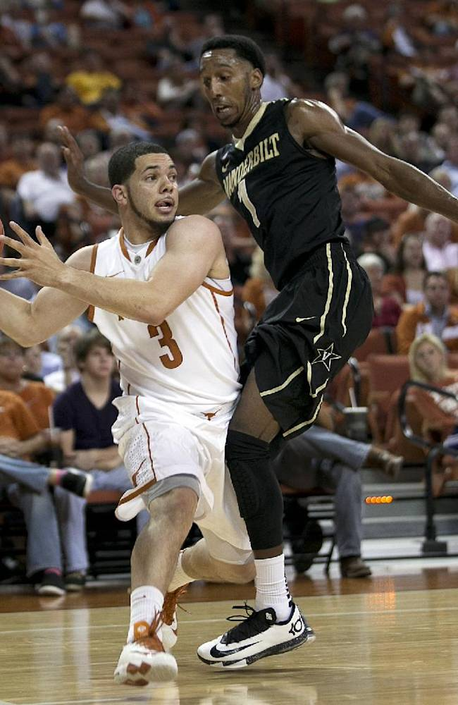 Texas holds back late charge from Vanderbilt 70-64