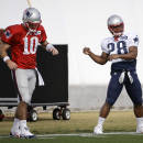 New England Patriots quarterback Jimmy Garoppolo (10) and running back James White (28) warm up during practice Wednesday, Jan. 28, 2015, in Tempe, Ariz. The Patriots play the Seattle Seahawks in NFL football Super Bowl XLIX Sunday, Feb. 1, in Glendale, Ariz. (AP Photo/Mark Humphrey)
