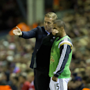 Swansea's manager Garry Monk, left, issues instructions to substitute Wayne Routledge during the English League Cup soccer match between Liverpool and Swansea at Anfield Stadium, Liverpool, England, Tuesday Oct. 28, 2014