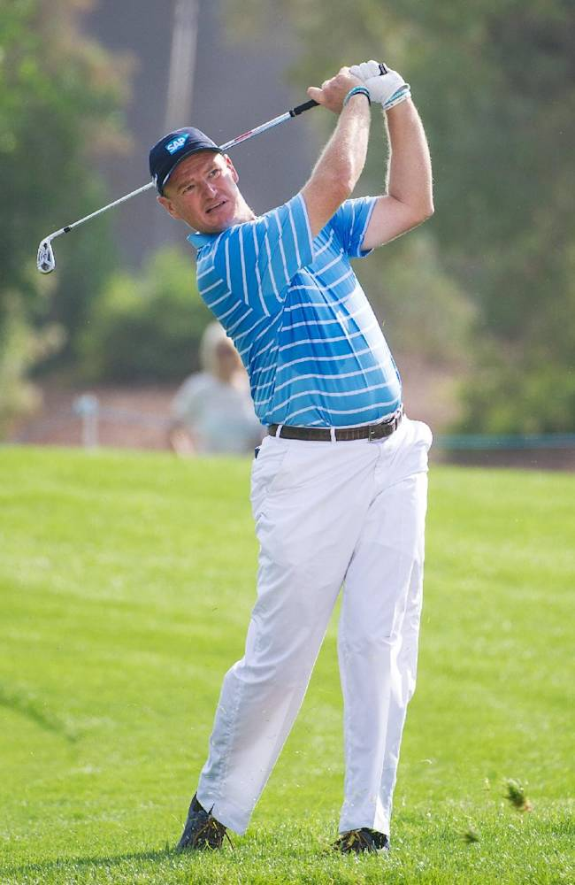 Ernie Els of South Africa plays a shot on teh first fairway during the first day of The DP World Tour Championship, held at Jumeirah Golf Estates in Dubai, United Arab Emirates, on Thursday,  Nov. 20, 2014