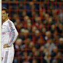Real Madrid's Cristiano Ronaldo grimaces during the Champions League group B soccer match between Liverpool and Real Madrid at Anfield Stadium, Liverpool, England, Wednesday Oct. 22, 2014