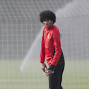 Manchester United's Marouane Fellaini trains with teammates at Carrington training ground in Manchester, Monday, March 31, 2014. Manchester United will play Bayern Munich in a Champions League quarter final first leg soccer match on Tuesday