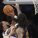 Sacramento Kings forward Derrick Williams, left, goes up for a shot as Los Angeles Lakers forward Jordan Hill defends during the first half of an NBA basketball game, Friday, Feb. 28, 2014, in Los Angeles The Associated Press