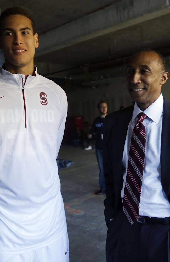 Stanford's Dwight Powell, left, and head coach Johnny Dawkins smile as they prepare for interviews at the Pac-12 NCAA college basketball media day on Thursday, Oct. 17, 2013, in San Francisco