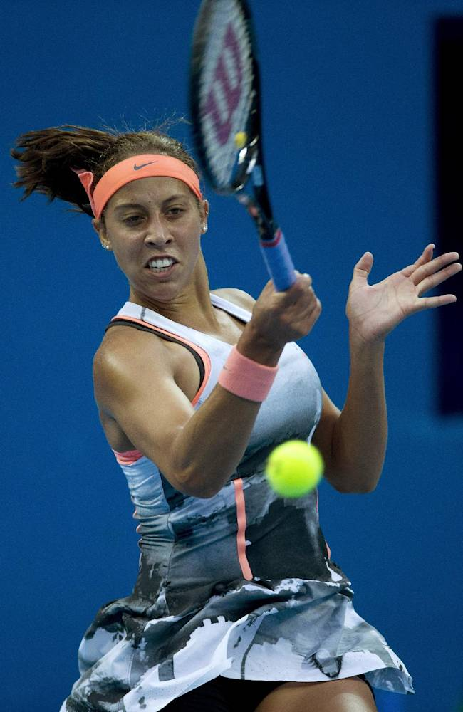 Madison Keys of the U.S. returns a shot to Agnieszka Radwanska of Poland during the China Open tennis tournament at the National Tennis Stadium in Beijing, China Wednesday, Oct. 2, 2013