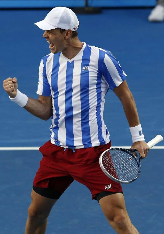 Tomas Berdych of the Czech Republic  celebrates after his win over Kevin Anderson of South Africa during their fourth round match at the Australian Open tennis championship in Melbourne, Australia, Sunday, Jan. 19, 2014