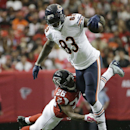Chicago Bears tight end Martellus Bennett (83) runs by Atlanta Falcons cornerback Josh Wilson (26) during the first half of an NFL football game, Sunday, Oct. 12, 2014, in Atlanta The Associated Press