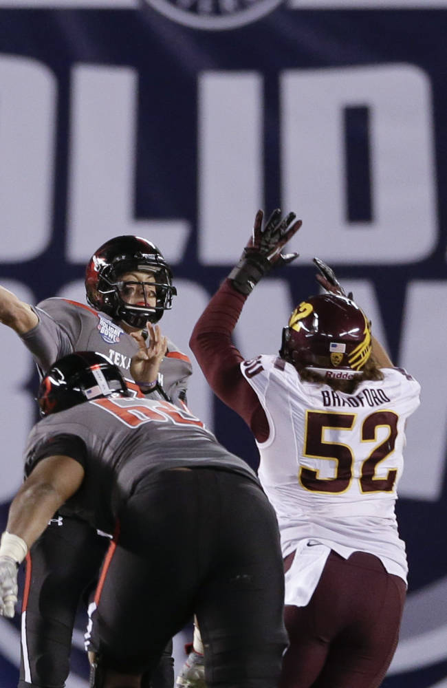 Texas Tech quarterback Davis Webb, left, throws a pass under pressure from Arizona State linebacker Carl Bradford, right, in the second half during the Holiday Bowl NCAA college football game Monday, Dec. 30, 2013, in San Diego