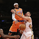 New York Knicks forward Carmelo Anthony (7) knocks the ball from the grasp of New Orleans Pelicans forward Ryan Anderson (33) in the first half of their NBA basketball game at Madison Square Garden in New York, Sunday, Dec. 1, 2013 The Associated Press