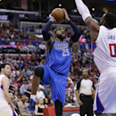 Dallas Mavericks' Vince Carter, center, looks to shoot as he is defended by Los Angeles Clippers' Glen Davis during the second half of an NBA basketball game on Thursday, April 3, 2014, in Los Angeles. The Mavericks won 113-107 The Associated Press