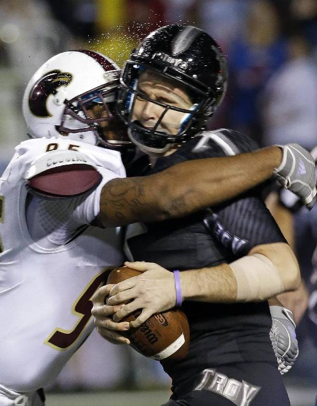 Troy quarterback Corey Robinson, right, is sacked by Louisiana-Monroe defensive end Darius Lively during the second half of an NCAA college football game in Troy, Ala., Thursday, Oct. 31, 2013. Louisiana-Monroe won Troy 49-37