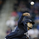 Atlanta Braves' Ervin Santana delivers a pitch during the first inning of a baseball game against the New York Mets on Saturday, April 19, 2014, in New York The Associated Press