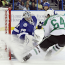 Dallas Stars left wing Brendan Ranford (64) shoots the puck past Tampa Bay Lightning goalie Ben Bishop (30) for a goal during the first period of an NHL preseason hockey game Friday, Sept. 26, 2014, in Tampa, Fla. The Associated Press