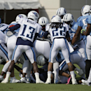 Tennessee Titans players join the scrum as safety Michael Griffin as wide receiver Justin Hunter scuffle during NFL football training camp Tuesday, July 29, 2014, in Nashville, Tenn The Associated Press
