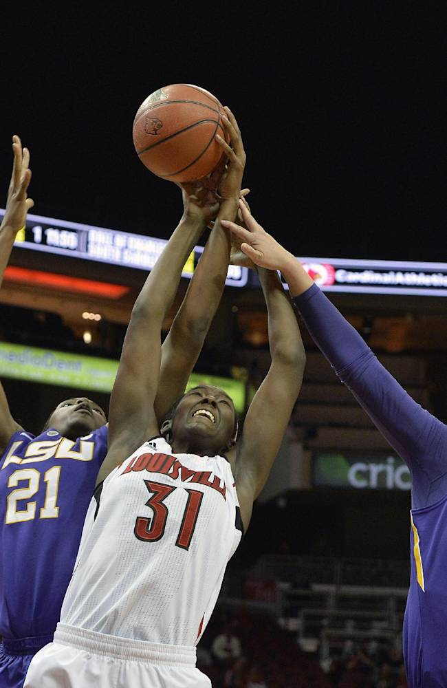 Louisville's Asia Taylor, center, battles LSU's Shanece McKinney, left, and Theresa Plaisance for a rebound during the second half of an NCAA college basketball game on Thursday, Nov. 14, 2013, in Louisville, Ky. Louisville defeated LSU 88-67