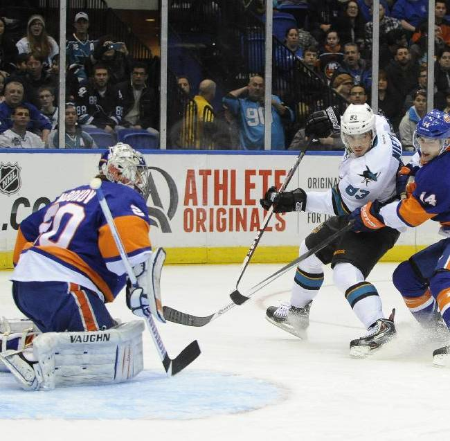 New York Islanders goalie Evgeni Nabokov (20) and Thomas Hickey (14) defend against San Jose Sharks' Matt Nieto (83)  in the first period of an NHL hockey game on Friday, March 14, 2014, in Uniondale, N.Y