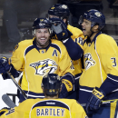 Nashville Predators forward Mike Fisher (12) and Seth Jones (3) celebrate a goal by James Neal (18), top, against the Washington Capitals in the second period of an NHL hockey game Friday, Jan. 16, 2015, in Nashville, Tenn The Associated Press
