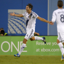 Los Angeles Galaxy defender Omar Gonzalez, left, celebrates after scoring as midfielder Marcelo Sarvas looks on during the second half of their International Champions Cup soccer match against Juventus, Saturday, Aug. 3, 2013, in Los Angeles. (AP Photo/Mark J. Terrill)