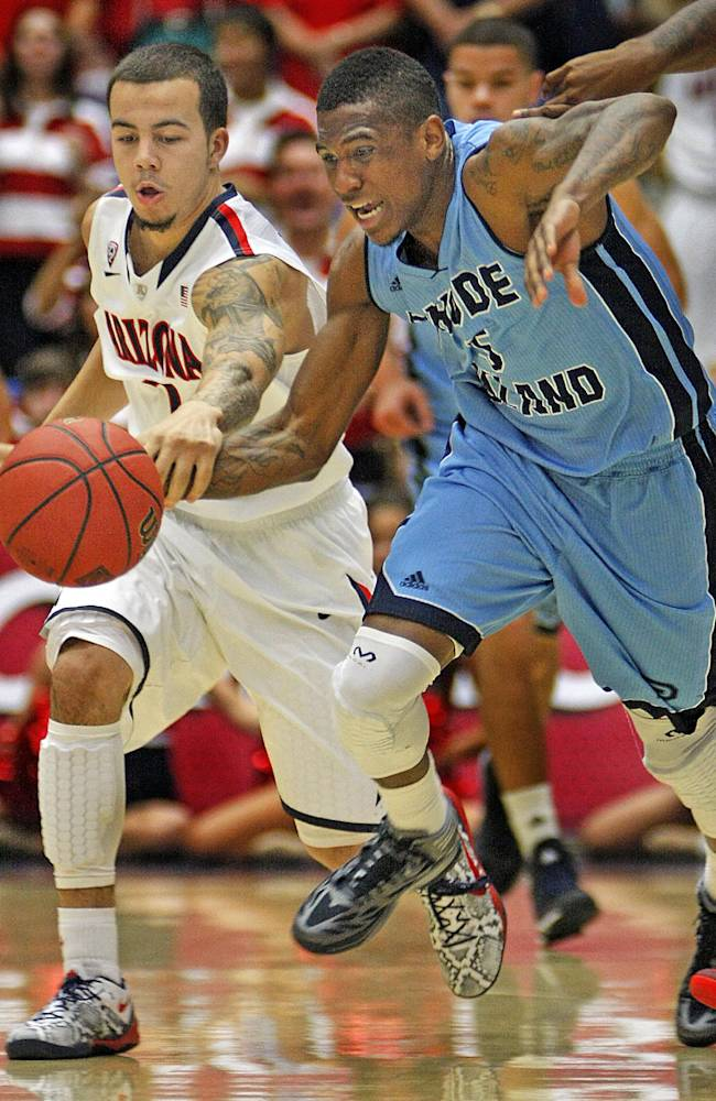 Rhode Island's Xavier Munford (5) and Arizona's Gabe York (1) battle for a loose ball in the second half of an NCAA college basketball game, Tuesday, Nov. 19, 2013 in Tucson, Ariz. This is in the second round of the NIT. Arizona won 87 - 59