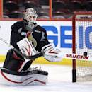 Ottawa Senators backup goaltender Robin Lehner stops the puck with his stick during practice in Ottawa, Ontario, Saturday, May 18, 2013, on the eve of Game 3 of the NHL hockey Stanley Cup playoff series against the Pittsburgh Penguins. (AP Photo/The Canadian Press, Fred Chartrand)