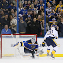 St. Louis Blues goaltender Brian Elliott makes the decisive save on a shot by Nashville Predators left wing James Neal in a shootout to win a game between the St. Louis Blues and the Nashville Predators on Thursday, Jan. 29, 2015, at the Scottrade Center