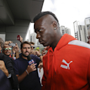 Italian soccer forward Mario Balotelli arrives at AC Milan headquarters, in Milan, Italy, Tuesday, Aug. 25, 2015. AC Milan's vice president Adriano Galliani said the club is in talks with Liverpool about bringing striker Mario Balotelli back to Serie