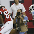 Atlanta Falcons wide receiver Roddy White (84) misses the ball against Tennessee Titans cornerback Blidi Wreh-Wilson (25) during the second half of an NFL preseason football game, Saturday, Aug. 23, 2014, in Atlanta The Associated Press
