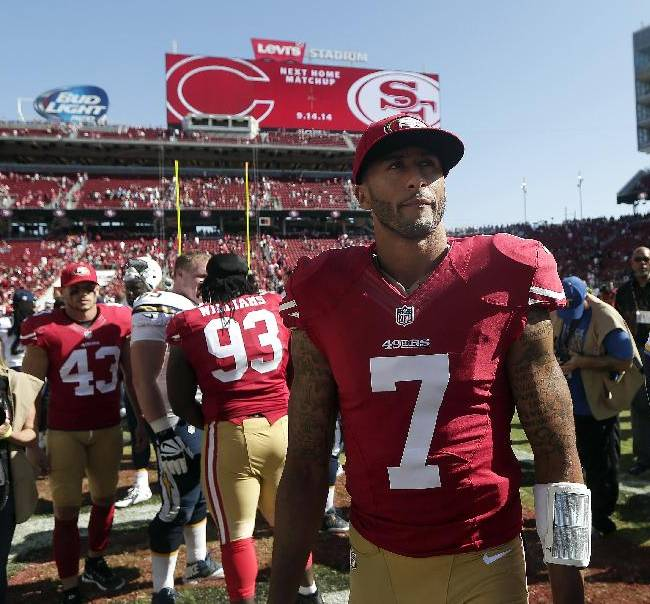 San Francisco 49ers quarterback Colin Kaepernick (7) walks off the field after an NFL preseason football game against the San Diego Chargers in Santa Clara, Calif., Sunday, Aug. 24, 2014. The 49ers won 21-7