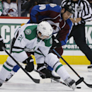 Dallas Stars left wing Antoine Roussel, left, of France, puts the stick between his legs to gain control of the puck in front of Colorado Avalanche center Ryan O'Reilly in the second period of an NHL hockey game Saturday, Jan. 10, 2015, in Denver The Asso