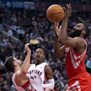 Toronto Raptors guard Greivis Vasquez, left, is knocked down by Houston Rockets guard James Harden, right, during second-half NBA basketball action in Toronto, Wednesday, April 2, 2014 The Associated Press
