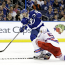 Tampa Bay Lightning right wing Teddy Purcell (16) fires the puck past New York Rangers defenseman Dan Girardi (5) for a goal during the second period of an NHL hockey game Monday, Nov. 25, 2013, in Tampa, Fla The Associated Press