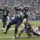 Seattle Seahawks' Marshawn Lynch (24) scores as quarterback Russell Wilson (3) reacts behind and Chicago Bears' Danny McCray hits the turf in the first half of an preseason NFL football game, Friday, Aug. 22, 2014, in Seattle The Associated Press