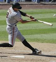 San Francisco Giants' Hunter Pence hits a two run home run against the Los Angeles Dodgers during sixth inning of a baseball in Los Angeles, Sunday, Sept. 15, 2013. (AP Photo/Chris Carlson)