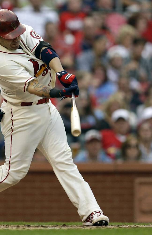 St. Louis Cardinals' Yadier Molina hits a two-run double during the third inning of a baseball game against the Chicago Cubs, Saturday, Sept. 28, 2013, in St. Louis