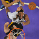 Sacramento Kings forward Jason Thompson, top, puts up a shot as Los Angeles Lakers center Pau Gasol, of Spain, during the second half of an NBA basketball game, Friday, Feb. 28, 2014, in Los Angeles The Associated Press