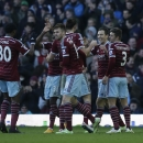 West Ham's Stewart Downing, second right, celebrates with his teammates after scoring his side's third goal during the English Premier League soccer match between West Ham and Hull City at Upton Park stadium in London, Sunday, Jan. 18, 2015