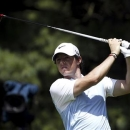 Rory McIlroy of Northern Ireland watches his tee shot on the second hole during the first round of the WGC-Bridgestone Invitational golf tournament in Akron, Ohio, August 1, 2013. REUTERS/Matt Sullivan