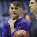 James Madison head coach Matt Brady talks with an assistant during practice at the NCAA college basketball tournament, Thursday, March 21, 2013, in Dayton, Ohio. James Madison plays Indiana Friday. (AP Photo/Al Behrman)