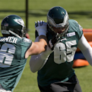 Philadelphia Eagles offensive tackle Lane Johnson (65) and tackle Andrew Gardner (66) run a drill during NFL football practice at the team's training facility, Tuesday, Sept. 30, 2014, in Philadelphia The Associated Press