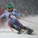 Alexander Khoroshilov, of Russia, speeds past a pole on his way to clock the fastest time during the first run of a men's World Cup slalom event, in Schladming, Austria, Tuesday, Jan. 27, 2015. (AP Photo/Giovanni Auletta)